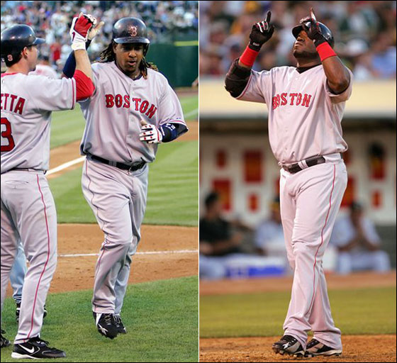 Red Sox's Manny Ramirez, right, is greeted at the plate by teammates Mark Loretta (3) and Kevin Youkilis after Ramirez's three- run home run off the Oakland Athletics' Barry Zito in the third inning of a baseball game on Monday, July 24, 2006, in Oakland, Calif.; Red Sox's Manny Ortiz points skyward as he reaches home plate after hitting a solo home run off Oakland Athletics' Barry Zito in the fifth inning of a baseball game Monday, July 24, 2006, in Oakland, Calif.