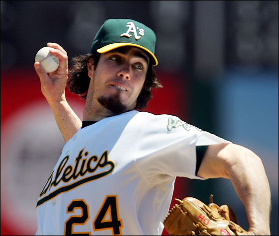 Oakland Athletics starter Dan Haren throws to the Boston Red Sox in the first inning of a baseball game, Wednesday, July 26, 2006, in Oakland, Calif.