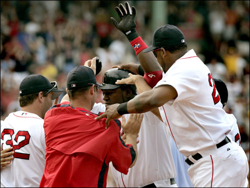 David Ortiz was mobbed by his teammates after his game winning RBI single.