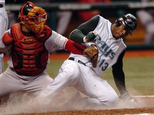 Tampa Bay Devil Rays' Carl Crawford (13) beats the tag from Red Sox catcher Jason Varitek as he steals home during the fourth inning of a baseball game Wednesday, July 5, 2006, in St. Petersburg, Fla.