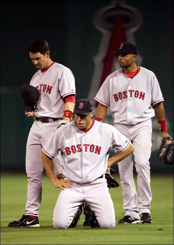 Mark Loretta (left), and Gabe Kapler (center) recovered from their collision while Coco Crisp looked on. Both players remained in the game.