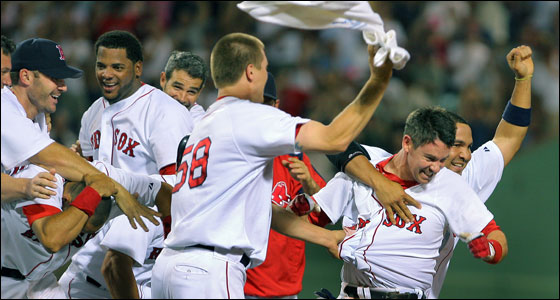Mark Loretta was mobbed by teammates after his dramatic walkoff double gave Boston a 6-5 victory over the Indians.