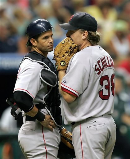 Red Sox pitcher Curt Schilling, right, talks with the team's newly acquired catcher, Javy Lopez, during the sixth inning of a baseball game with the Tampa Bay Devil Rays on Friday night, Aug. 4, 2006, in St. Petersburg, Fla. Lopez was traded from the Baltimore Orioles earlier in the day. He came into the game in the second inning after Doug Mirabelli injured his ankle.