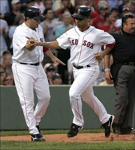 Doug Mirabelli, at far left, greets Alex Cora at home after they both scored on a bases loaded single by Mark Loretta in a 6 run 2nd inning.