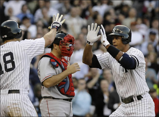 New York Yankees' Alex Rodriguez celebrates with Johnny Damon who scored on Rodriguez's second-inning, two-run home run off Boston Red Sox's Tim Wakefield in their baseball game at Yankee Stadium in New York, Monday, May 21, 2007.