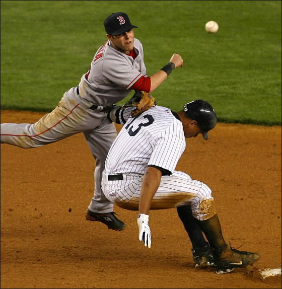 Dustin Pedroia of the Red Sox throws to first as Alex Rodriguez  of the New York Yankees breaks up the double play in the 8th inning 22 May 2007 at Yankee Stadium in the Bronx borough of New York City.