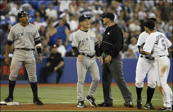 New York Yankees' Alex Rodriguez (L) and third base coach Larry Bowa argue with Toronto Blue Jays players Howie Clark and John McDonald as umpire Chad Fairchild (C) watches during the ninth inning of their MLB American League baseball game in Toronto May 30, 2007