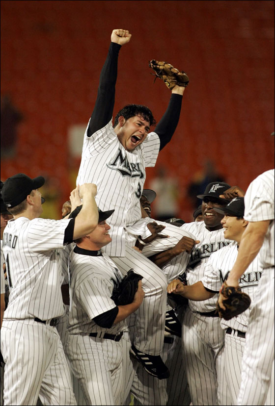 Florida Marlins pitcher Anibal Sanchez of Venezuela is hoisted atop his teammates' shoulders as they celebrate his 2-0 n0-hit win over the Arizona Diamondbacks Wednesday, Sept. 6, 2006, at Dolphin Stadium in Miami.