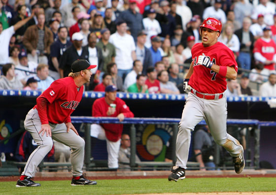 Adam Stern (No. 7) of Team Canada rounds the bases after hitting a inside the park home run against Team USA during the Round 1 Pool B Game of the World Baseball Classic on March 8, 2006 at Chase Field in Phoenix, Arizona.