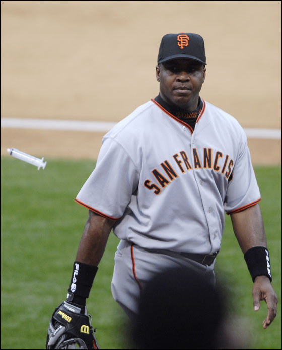 San Francisco Giants' Barry Bonds tosses a plastic syringe, thrown to Bonds by a fan, to a security guard as he returns to the dugout following the eighth inning of the Giants' 6-1 baseball loss to the San Diego Padres Monday, April 3, 2006, in San Diego.