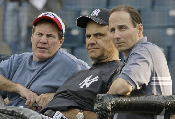 New England Patriots head coach Bill Belichick, left, New York Yankees manager Joe Torre, center, and Yankees general manager Brian Cashman chat while seated behind the batting cage as the Yankees and Tampa Bay Devil Rays warmed up before their spring training game at Legends Field in Tampa, Fla., Friday, March 9, 2007.