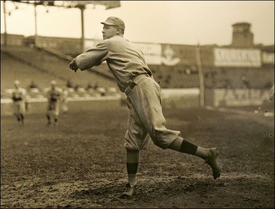 Red Sox pitcher Babe Ruth warms up prior to a 1915 World Series game start in Philadelphia's Shibe Park. The photo, printed from a 4x5 glass plate is part of a baseball exhibit at the Panopticon Gallery inside the Commonwealth Hotel in Kenmore Square.