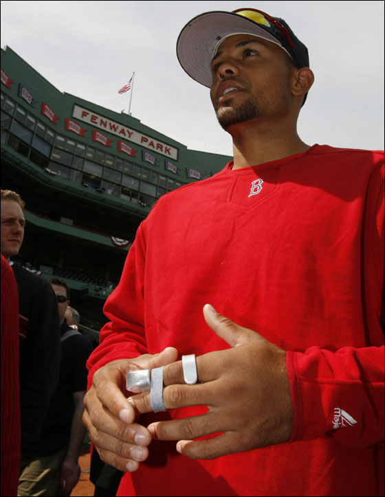 Red Sox Coco Crisp talking to reporters with his left knuckle in a splint after breaking it on a steal attempt of third base in Baltimore before the start of their home season opener at Fenway Park
