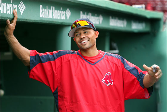 With his newly signed three year contract extension all done, injured Red Sox centerfielder Coco Crisp has a chuckle while standing under an appropriate sign in the home dugout during batting practice.