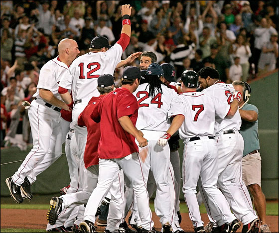 Coco Crisp is at the center of the Red Sox celebration after his game winning double in the 9th inning.