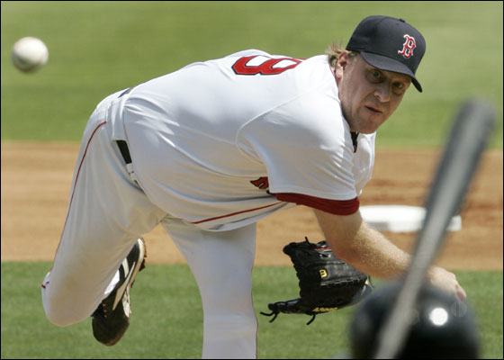 Red Sox starter Curt Schilling delivers to Baltimore Orioles Brian Roberts during their spring training baseball game in Fort Myers, Fla., Friday March 23, 2007.  Schilling got the win, giving up two runs and six hits over seven innings, as the Sox defeated the Orioles 3-2.