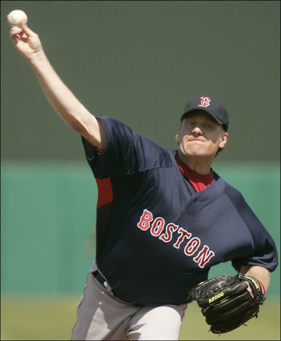 Red Sox pithcer Curt Schilling delivers a throw while warming up before pitching in the first inning of a spring training baseball game against the Minnesota Twins at Hammond Stadium, in Fort Myers, Fla., Thursday, March 8, 2007.