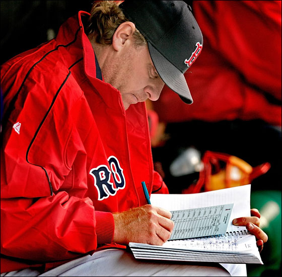 Red Sox starter Curt Schilling adds some entries to his notebook after pitching 8 innings, 4 hits and no runs