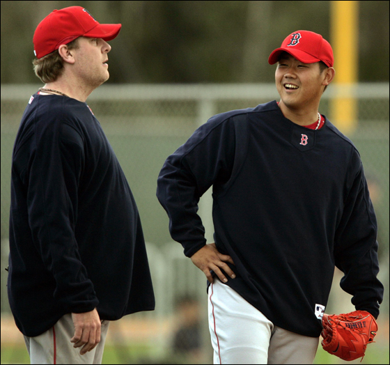 Boston Red Sox pitchers Schilling and Matsuzaka share a laugh on the first day of full practices in Fort Myers. Boston Red Sox pitchers Curt Schilling (L) and Daisuke Matsuzaka of Japan share a laugh on the first day of full practices at the team's spring training facility in Fort Myers, Florida February 18, 2007.