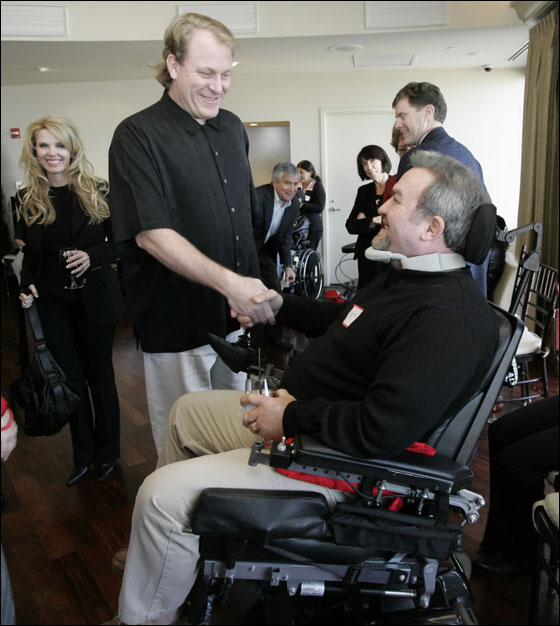 Boston, MA 12/03/06 Boston Red Sox pitcher Curt Schilling and his wife Shonda host a private reception to thank 2006 Curt's Pitch for ALS members in Boston, MA on Sunday, December 3, 2006. Curt is greeting Keith Moegle of Hull. Keith is an ALS patient.