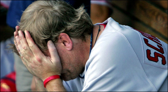 Red Sox starting pitcher Curt Schilling is despondent in the dugout after the bottom of the fourth inning, in which Kansas City scored three times off of him. It would be his last inning of the game.
