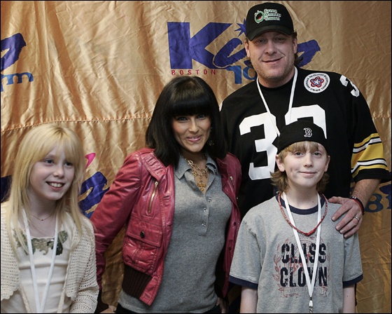 Curt Schilling poses with Canadian singer-songwriter Nelly Furtado and his two children Gabriella, left, and Gehrig backstage at the Kiss 108 Boston Jingle Ball at the Tsongas Arena in Lowell, Mass., Thursday, Dec. 14, 2006
