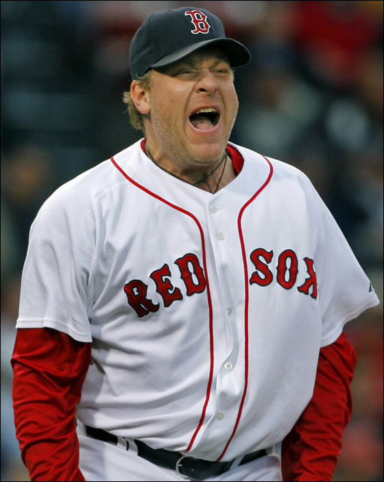Red Sox starting pitcher Curt Schilling saw his first mound appearence since his near no-hitter in Oakland to be not quite as much fun. Here he reacts after walking Todd Helton (not pictured) on a 3 and 2 pitch in the first inning.