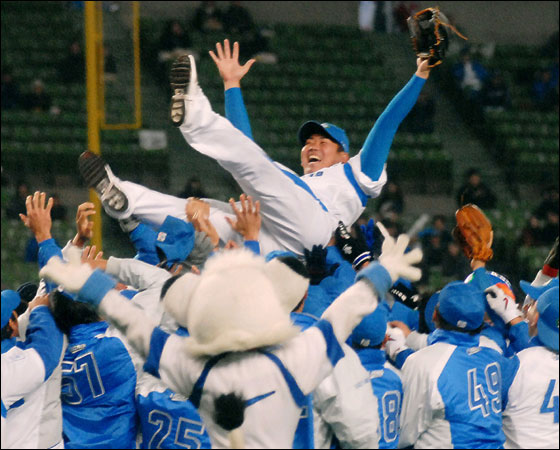 Seibu Lions pitcher Daisuke Matsuzaka is tossed in the air by his teammates in celebration of his transfer to the major league during an exhibition game held as part of the fans' gathering at their home ground of Invoice Seibu Dome in Tokorozawa, west of Tokyo, Thursday, Nov. 23, 2006. Boston Red Sox bid US$51.1 million for the right to negotiate with 26-year-old right-hander, who was the MVP of last spring's World Baseball Classic. 3,6000 Lions fans converged for the annual event, a local report said.