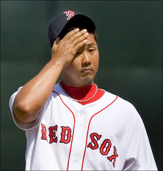 Red Sox pitcher Daisuke Matsuzaka wipes his brow after giving up a fourth inning home run against the Orioles. It was the second HR Matsuzaka gave up.