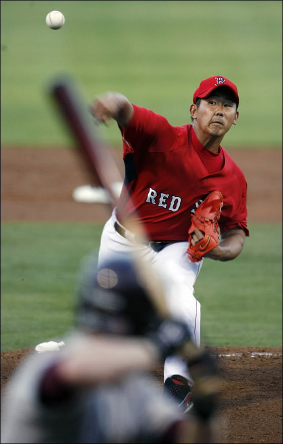 Red Sox pitcher Daisuke Matsuzaka fires a pitch during tonight's game vs. Boston College at City of Palms Park.