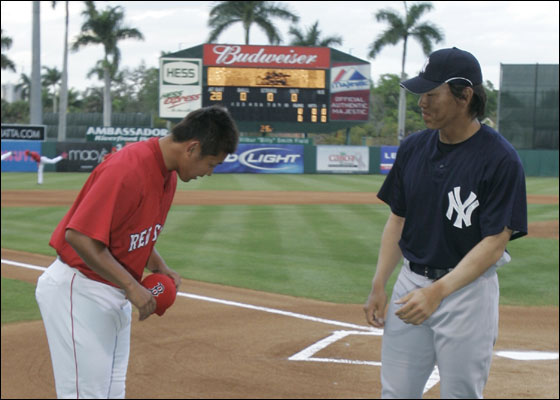 Red Sox pitcher Daisuke Matsuzaka, left, and New York Yankees outfielder Hideki Matsui greet at home plate prior to their spring training baseball game in Fort Myers, Fla., Monday, March 12, 2007.