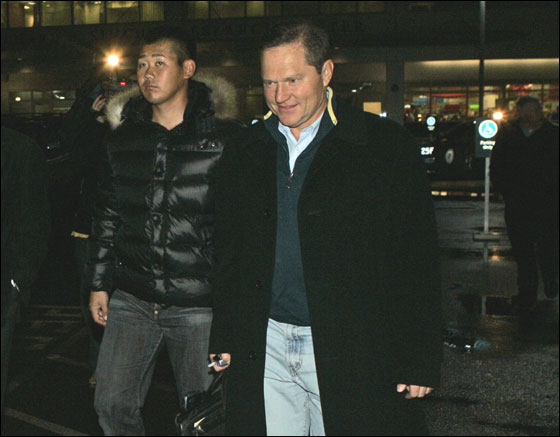 Japanese pitcher Daisuke Matsuzaka arrives with his agent Scott Boras, right, in Boston, Wednesday, Dec. 13, 2006, as negotiations with the Boston Red Sox neared agreement on a $52 million, six-year contract.