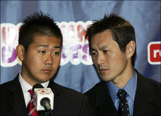 Daisuke Matsuzaka looks on as Tak Sato translates for him during a press conference announcing that the pitcher has signed with the Boston Red Sox on December 14, 2006 at Fenway Park in Boston, Massachusetts. Matsuzaka will get $52 million over six years.