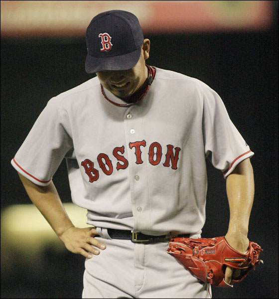 Red Sox pitcher Daisuke Matsuzaka, of Japan, reacts as he walks off the field after the third inning of a baseball game against the Texas Rangers, Friday, May 25, 2007, in Arlington, Texas.
