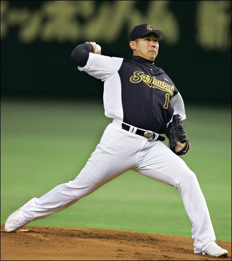 Japanese pitcher Daisuke Matsuzaka throws out an opening pitch during an exhibition game between his semiprofessional ball club Yokohama Samurai and the Ibaraki Golden Golds at Tokyo Dome in Tokyo Sunday, Jan. 7, 2007. Matsuzaka joined the Boston Red Sox on Dec. 14 2006, on a six-year, $52-million contract.