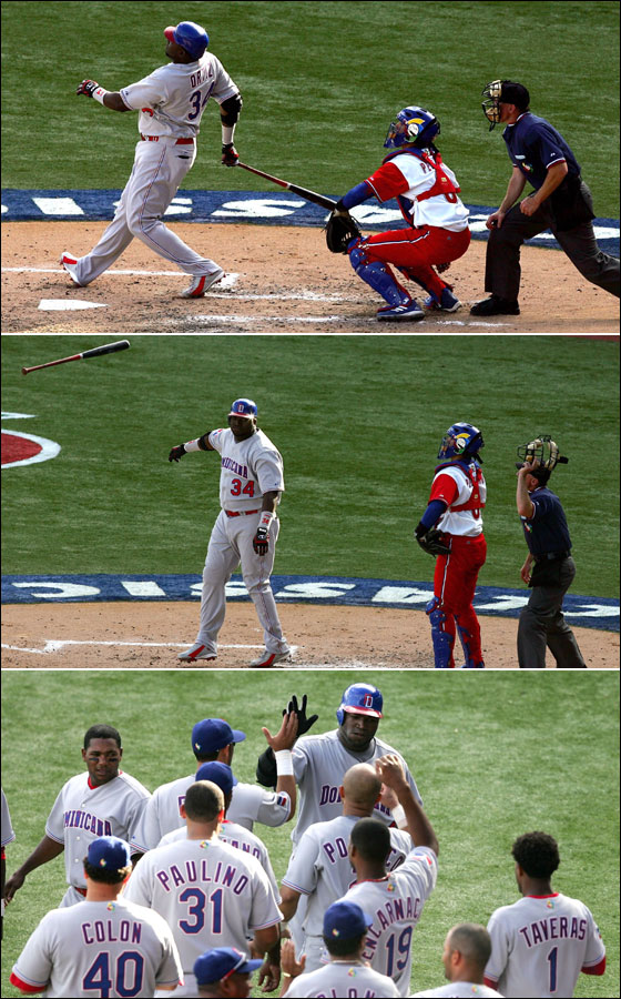 David Ortiz follows through for a solo-home run to right field off team Cuba reliever Jonder Martinez in the fifth inning in Round 2 of the World Baseball Classic in San Juan, Puerto Rico, Monday, March 13, 2006