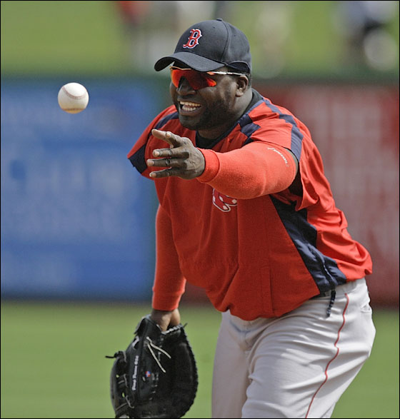 Boston Red Sox first baseman David Ortiz tosses a ball to first while taking fielding practice before the Red Sox faced the Philadelphia Phillies in their spring training baseball game in Clearwater, Fla., Thursday, March 22, 2007.