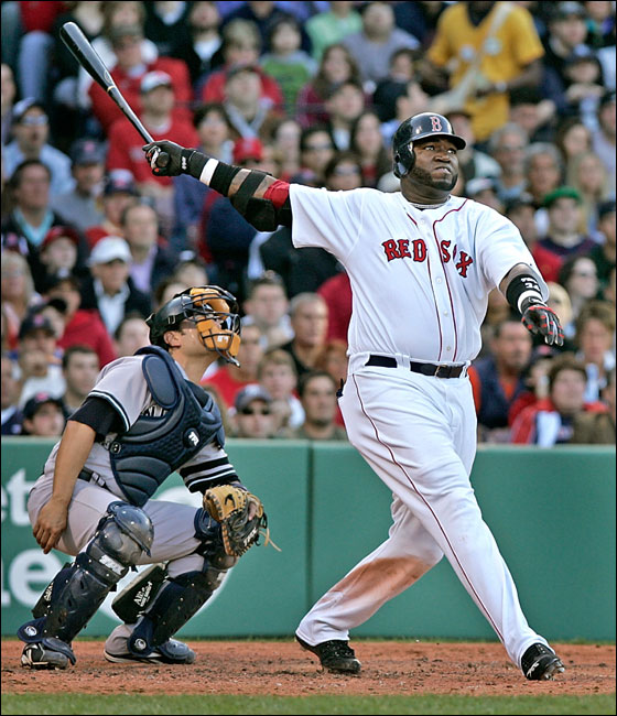 Boston Red Sox designated hitter David Ortiz watches the flight of his fourth inning two-run home run.