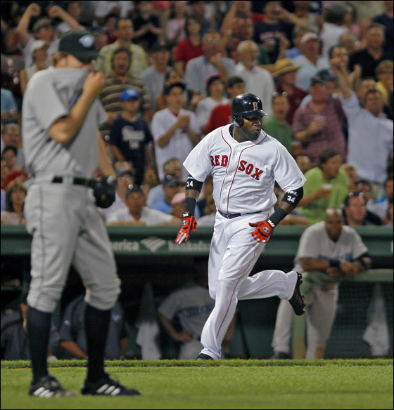 Red Sox DH David Ortiz, he of the balky right knee, motors toward the plate on it as he scores on a Manny Rqmirez sixth inning double off of Toronto reliever Casey Janssen