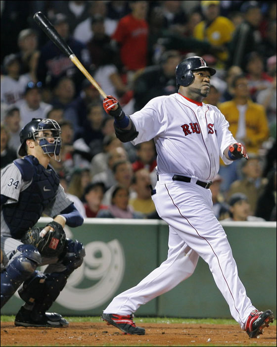 David Ortiz follows through after hitting his 51st home run of the season during a baseball game against the Minnesota Twins at Fenway Park in Boston Thursday night, Sept. 21, 2006. Fifty-one home runs is the most by any Red Sox player in a single season.