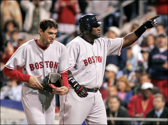 Boston Red Sox' David Ortiz, right, points to fans after his two-run home run knocked in Red Sox starting pitcher Matt Clement, left, against the Philadelphia Phillies in the fifth inning of their baseball game Friday, May 19, 2006, in Philadelphia.