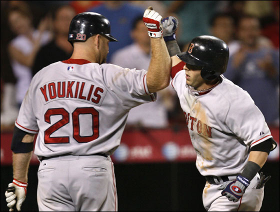 Red Sox second baseman Dustin Pedroia, right, gets kudos from on deck batter Kevin Youkilis after hitting a solo homer against the Los Angeles Angels in the seventh inning of a baseball game in Anaheim, Calif., Wednesday, Aug. 8, 2007.
