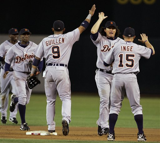 Detroit Tigers' Carlos Guillen (9), Magglio Ordonez and Brandon Inge celebrate their 8-5 victory over the Oakland Athletics in Game 2 of the American League Championship Series in Oakland, Calif., Wednesday, Oct. 11, 2006. The Tigers lead the series 2-0 games.