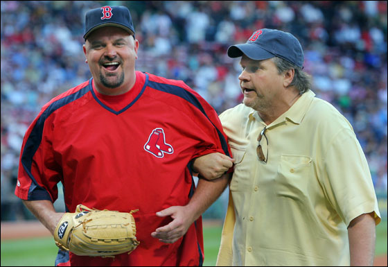 Singer Meatloaf threw out a ceremonial first pitch before the red Sox game. After the pitch he joked with Red Sox pitcher David Wells who caught his pitch.