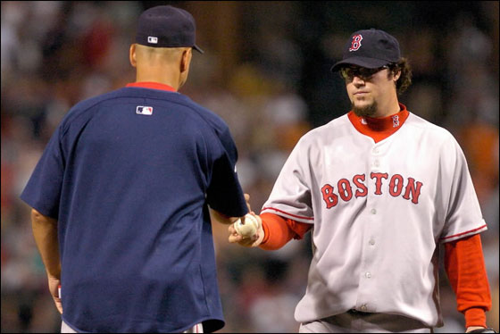 Eric Gagne of the Red Sox hands the ball to Manager Terry Francona after giving up 4 runs in the eighth inning against the Baltimore Orioles at Camden Yards August 10, 2007 in Baltimore, Maryland.