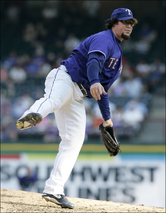 Texas Rangers pitcher Eric Gagne follows through on his delivery to the Seattle Mariners in the ninth inning of the first game of their baseball doubleheader in Arlington, Texas, Tuesday, July 24, 2007