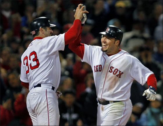 The Red Sox took the lead in the seventh inning on a two run home run by Eric Hinske, who is greeted by the man who scored ahead of him, Jason Varitek (left) after he crossed the plate.