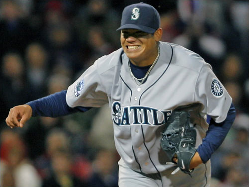Seattle pitcher Felix Hernandez reacts following the final out of his one hitter.