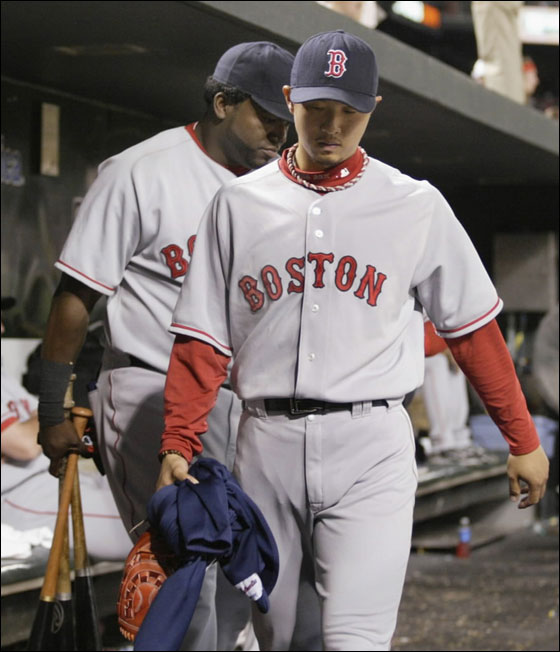 Red Sox relief pitcher Hideki Okajima (R) and designated hitter David Ortiz leave the dugout after losing to the Baltimore Orioles in their MLB American League baseball game in Baltimore, Maryland August 10, 2007. Okajimi was the losing pitcher in the game.