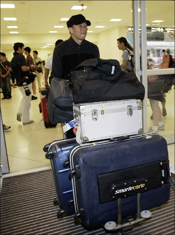 Boston Red Sox pitcher Hideki Okajima carries his luggage after he arrived at Southwest Florida International Airport in Fort Myers, Fla, Wednesday, Feb., 14, 2007 to attend baseball spring training camp.